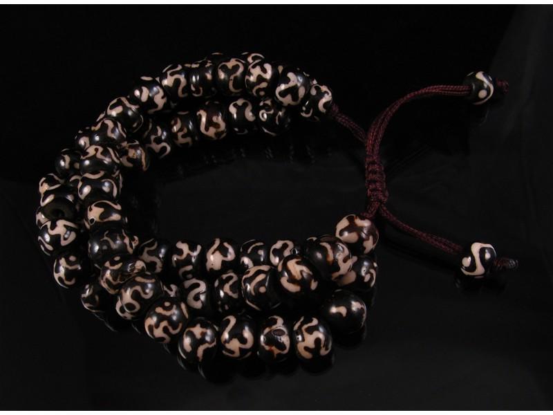 https://www.savdana.com/2491-thickbox_default/brmala21-bracelet-mala-de-prieres-tibetain-om-os-de-buffle.jpg